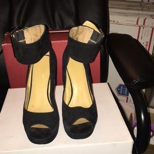 Black suede platform heels with ankle buckle